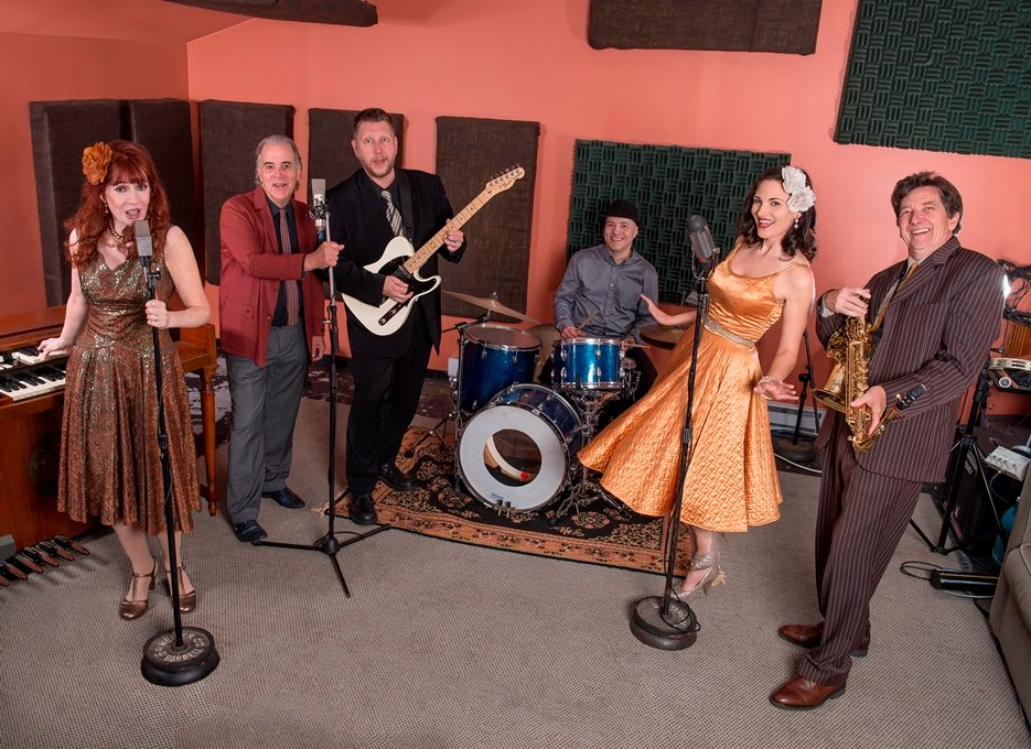 Eight to the Bar posing in their studio